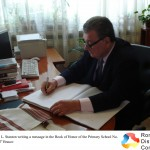 "Professor John L. Stanton writing a message in the Book of Honor of the Primary School No. 11 ""St. O. Iosif"" Brasov"
