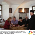 Carol Stanton, John Stanton, Theodor Valentin Purcarea, and Nicolae Albu sitting quietly in the old Anton Pann classroom of the First Romanian School