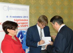 28. Alina BÂRGĂOANU, Guy VERHOFSTADT (giving autographs), and Theodor PURCĂREA