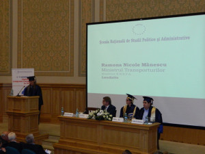 6.	Mrs. Ramona Nicole MĂNESCU, Minister of Transports, and a NUPSPA alumna,  reading the Laudatio